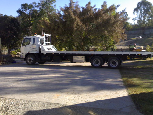 Hire Large Bogie Axle Tilt Tray - Carries up to 11 tonnes