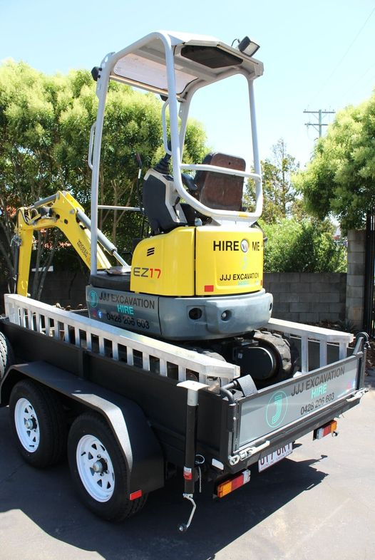 1.7 tonne excavator on a tipping trailer for hire